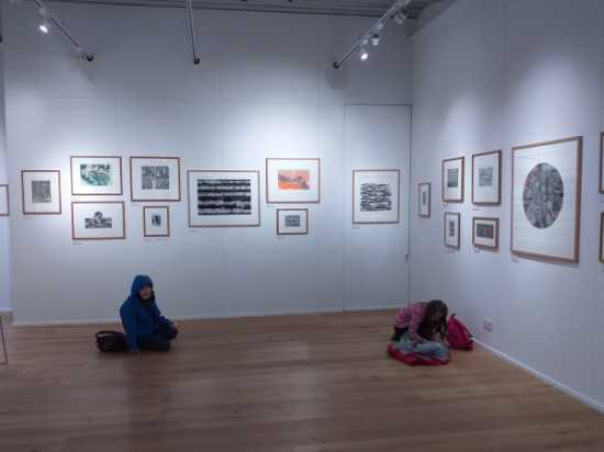 Children sketching at the exhibition